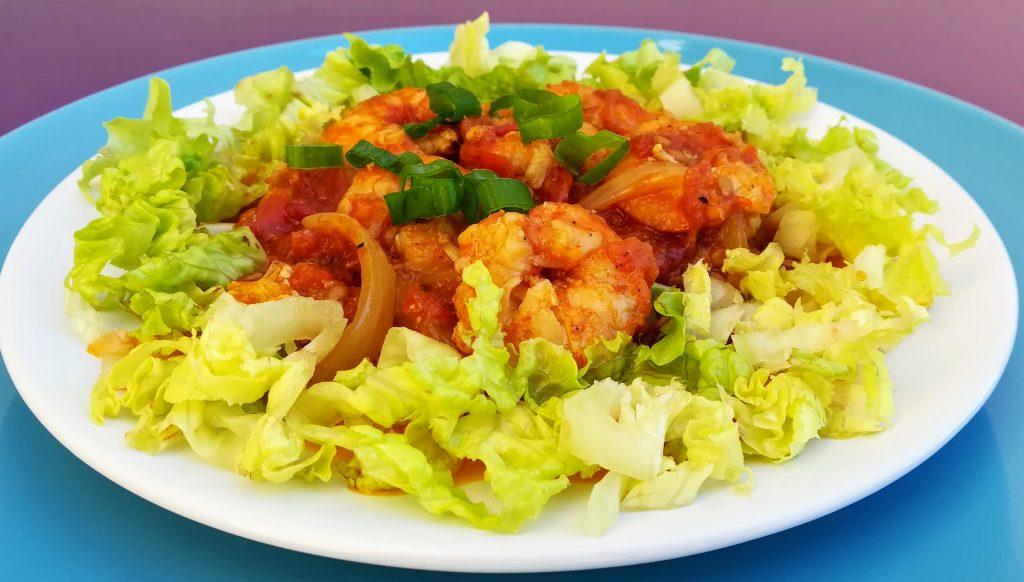 Crevettes en sauce tomates et au curry